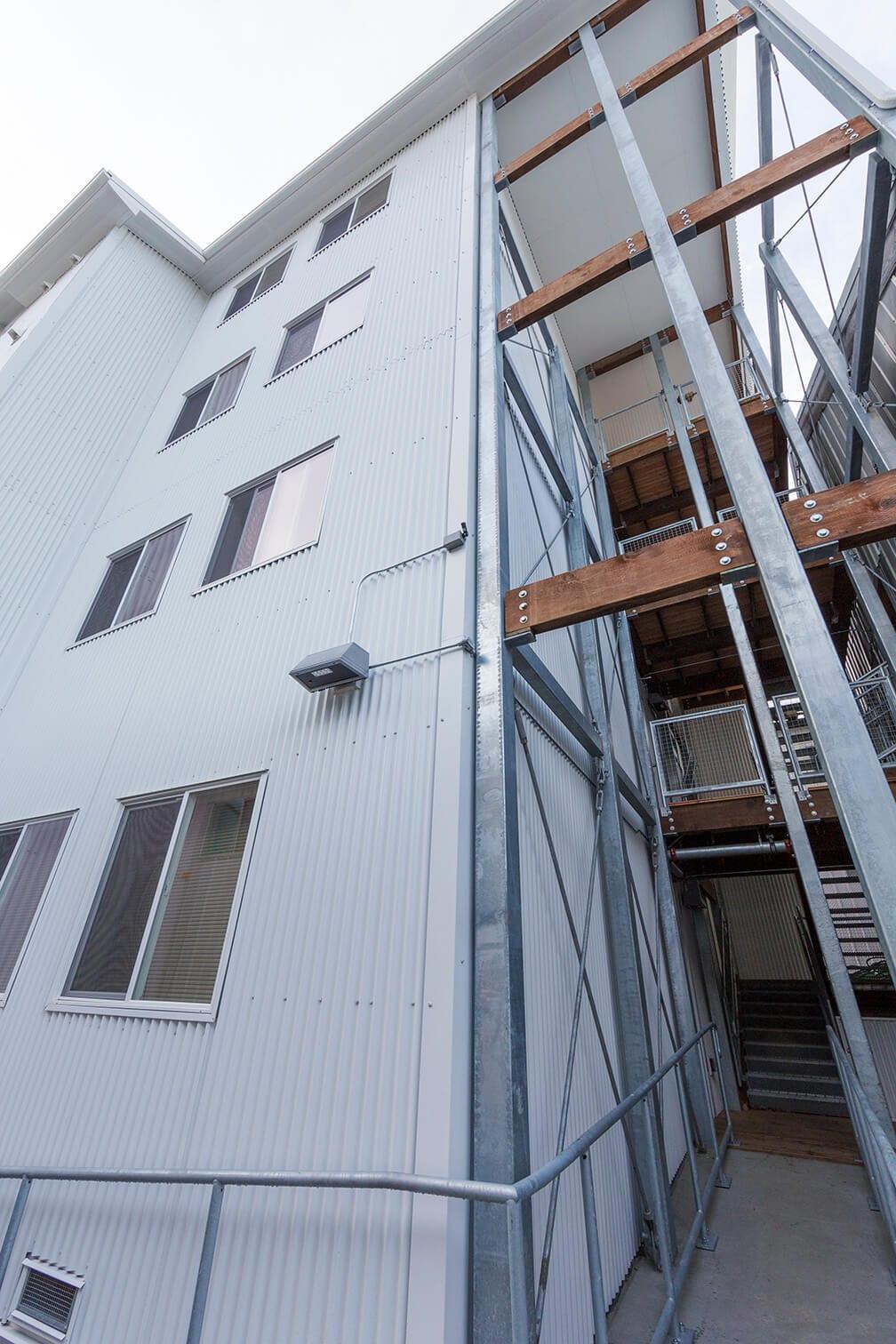 Expand Alaska Seafood's Bunkhouse Stairs Exterior